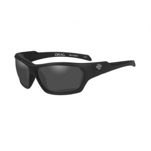 Harley-Davidson® Men's Drag Riding Sunglasses, HADRA01. Features a famous Bar & Shield logo printed on both temples. Smoke gray lens with matte black frames.Includes: soft pouch, that can double as a cleaning cloth. Eyewear meets ANSI Z87 high velocity impact and high mass impact requirements. Patented facial cavity seals. Soft foam Facial Cavity Seals, locks onto lightweight frames to help protect your eyes from wind and debris. Fits head sizes small and medium. Smoke gray lenses won't distort color perception because of their neutral gray color. These lenses provide excellent performance on bright days.